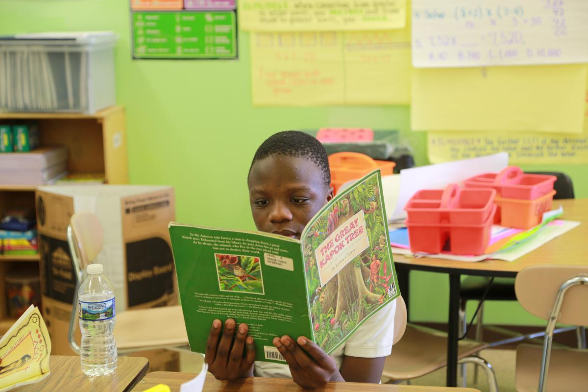 student reading in class