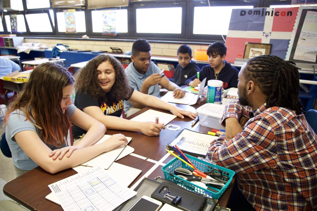 group work with the teacher and his students